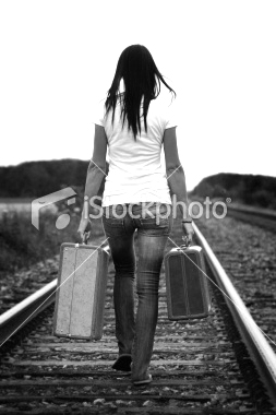 ist2_10058196-young-woman-walking-on-a-railroad-track